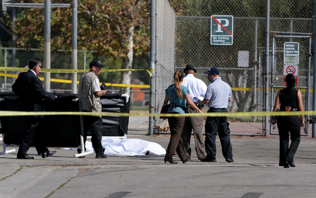 . Los Angeles Police Department officers investigate the scene of a shooting where one person was killed near the 14400 block of Polk Street in Sylmar, CA on August 24, 2014.  Describing what they called �a major public threat,� Los Angeles police said they are seeking clues to three separate shootings in the Northeast San Fernando Valley that left three people dead and four others injured early Sunday morning and appear to be connected. The three incidents, which were described as having �a similar manner,� took place between 5:50 and 6:45 a.m. Sunday in the city of San Fernando and in the Los Angeles communities of Sylmar and Pacoima, Los Angeles Police Department officials said. (Photo by Dean Musgrove/Los Angeles Daily News)