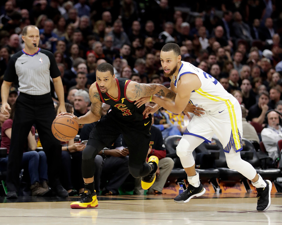 . Cleveland Cavaliers\' George Hill is chased by Golden State Warriors\' Stephen Curry during the second half of Game 3 of basketball\'s NBA Finals, Wednesday, June 6, 2018, in Cleveland. (AP Photo/Tony Dejak)