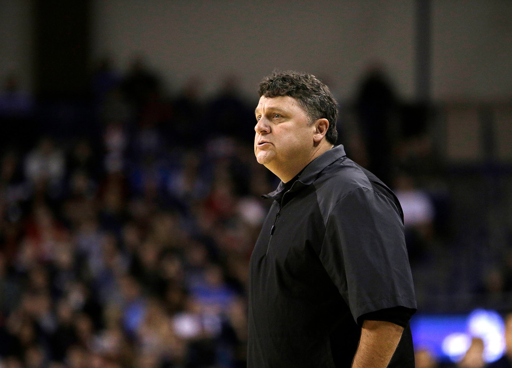 . Oakland\'s Head Coach Greg Kampe instructs his team during the first half of an NCAA basketball game against Gonzaga, in Spokane, Wash., on Sunday, Nov. 17, 2013. (AP Photo/Young Kwak)