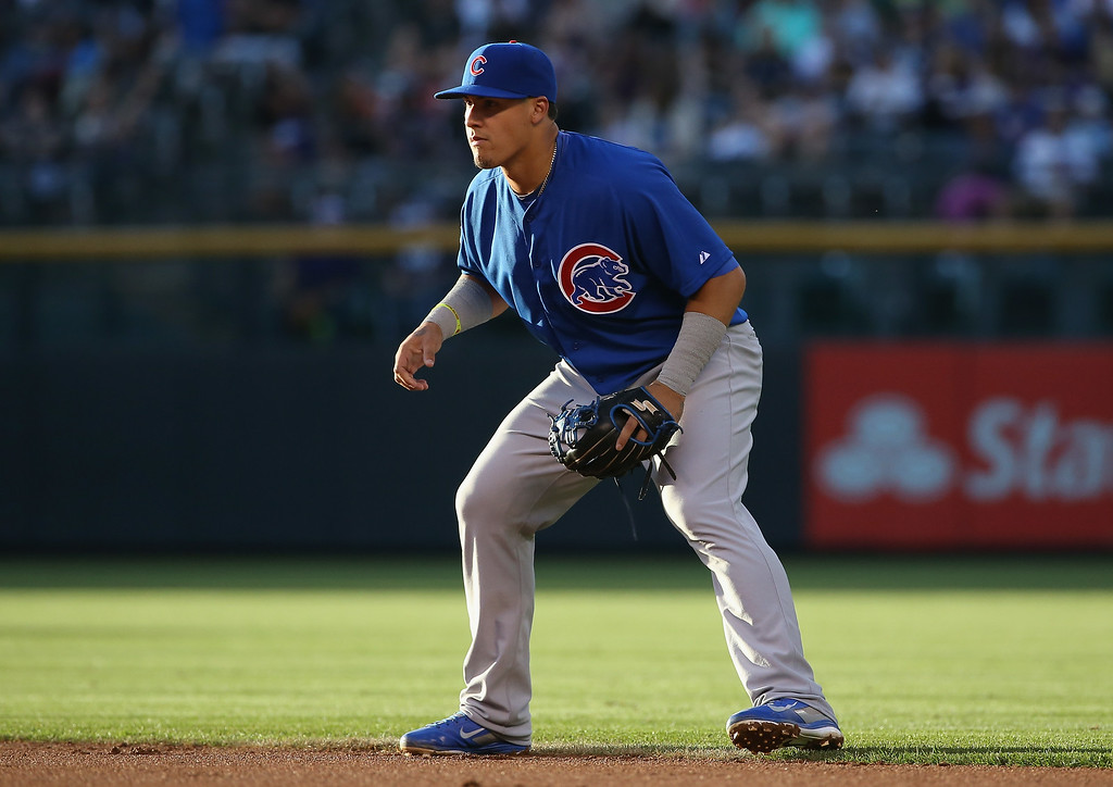 . DENVER, CO - AUGUST 05:  Second baseman Javier Baez #9 of the Chicago Cubs fouls plays defense against the Colorado Rockies at Coors Field on August 5, 2014 in Denver, Colorado.  (Photo by Doug Pensinger/Getty Images)