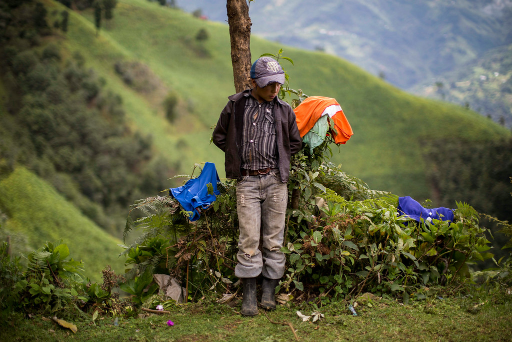 . Gilberto Haroldo Ramos Juarez, 11, brother of Gilberto Francisco Ramos Juarez, a Guatemalan boy whose decomposed body was found in the Rio Grande Valley of South Texas, stands in front of his home in San Jose Las Flores, in the northern Cuchumatanes mountains of Guatemala, Tuesday, July 1, 2014. Gilberto Francisco\'s parents confirmed to The Associated Press on Tuesday that he was 15, and the date was wrong on his birth certificate. In the remote mountains, they had taken several years to register his birth and forgot the date. So they listed the same date as his younger brother.  (AP Photo/Luis Soto)