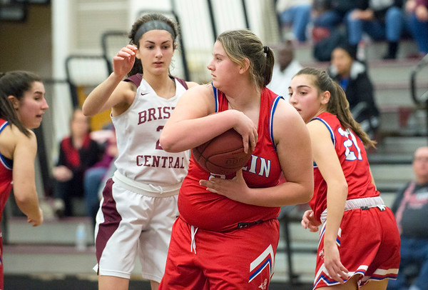 01/10/20 Wesley Bunnell | StaffrrThe Bristol Central girls basketball team was defeated at home on Friday night by Berlin. Berlin's Callie Gendron (34) comes up with the rebound against BC's Sophia Torreso (24).