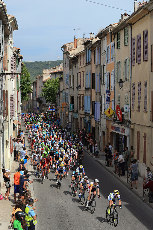 . The peloton passes through town as they approach the final climb of the day during stage five of the 2013 Tour de France, a 228.5KM road stage from Cagnes-sur-mer to Marseille, on July 3, 2013 in Cuge-les-Pins, France.  (Photo by Doug Pensinger/Getty Images)