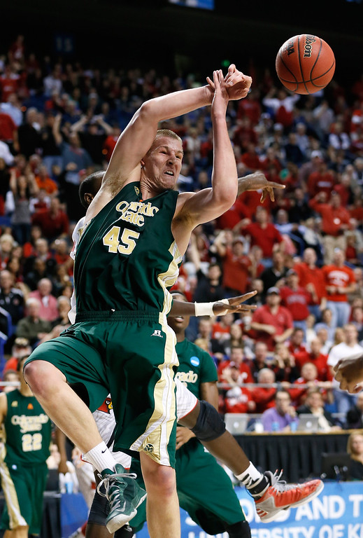 . LEXINGTON, KY - MARCH 23: Colton Iverson #45 of the Colorado State Rams has a rebound knocked away by Gorgui Dieng #10 of the Louisville Cardinals in the first half during the third round of the 2013 NCAA Men\'s Basketball Tournament at Rupp Arena on March 23, 2013 in Lexington, Kentucky.  (Photo by Kevin C. Cox/Getty Images)