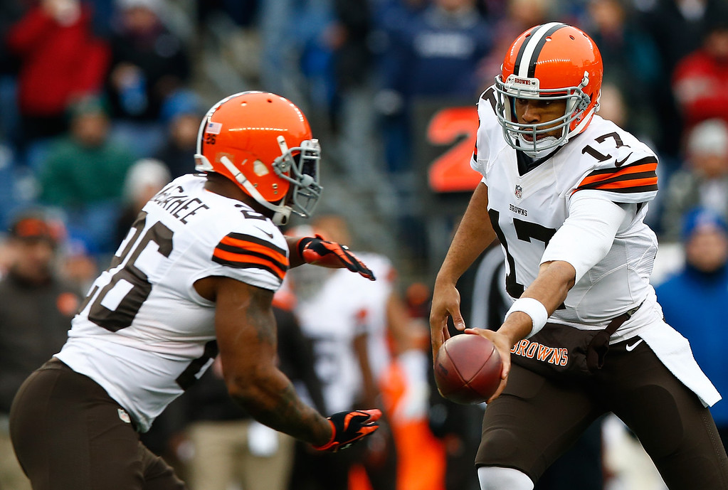 . Jason Campbell #17 hands the ball off to Willis McGahee #26 of the Cleveland Browns in the first quarter against the New England Patriots during the game at Gillette Stadium on December 8, 2013 in Foxboro, Massachusetts.  (Photo by Jared Wickerham/Getty Images)