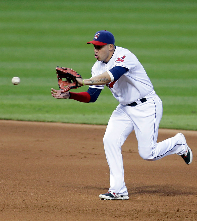 . Cleveland Indians\' Asdrubal Cabrera fields a ball hit by Detroit Tigers\' Rajai Davis in the fifth inning of a baseball game, Monday, May 19, 2014, in Cleveland. Davis was out at first base. (AP Photo/Tony Dejak)