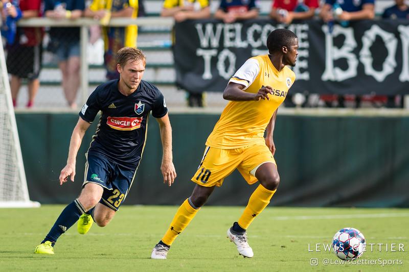 North Carolina FC midfielder Zach Steinberger (23) and Nashville SC midfielder Lebo Moloto (10)