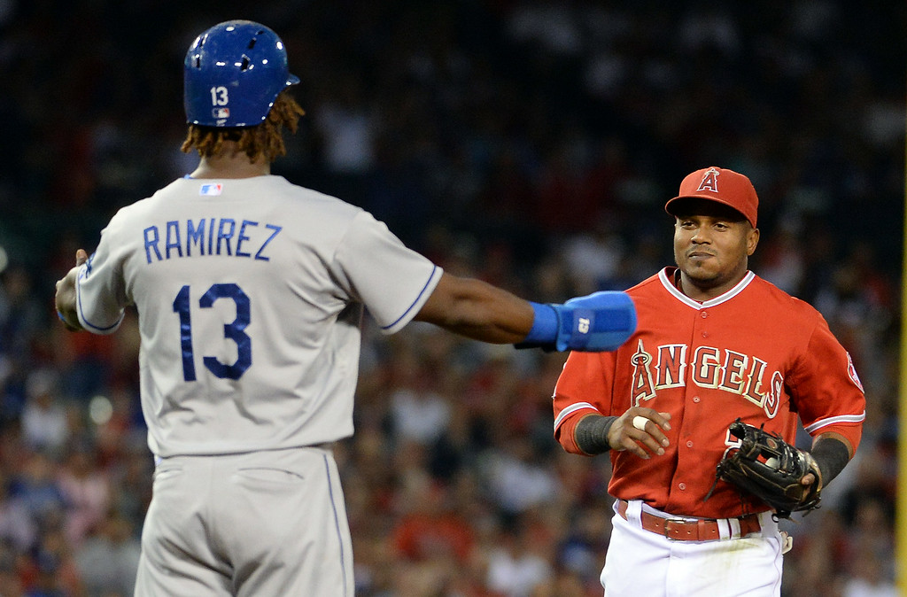 . Los Angeles Angels shortstop Erick Aybar tags out Los Angeles Dodgers\' Hanley Ramirez (13) in a run down between first and second in the third inning of a baseball game at Anaheim Stadium in Anaheim, Calif., on Thursday, Aug. 7, 2014.  (Photo by Keith Birmingham/ Pasadena Star-News)