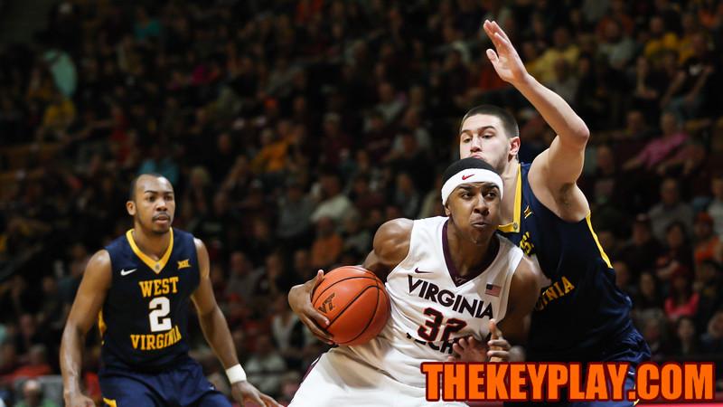 Zach Leday pushes past West Virginia's Nathan Adrian. (Mark Umansky/TheKeyPlay.com)