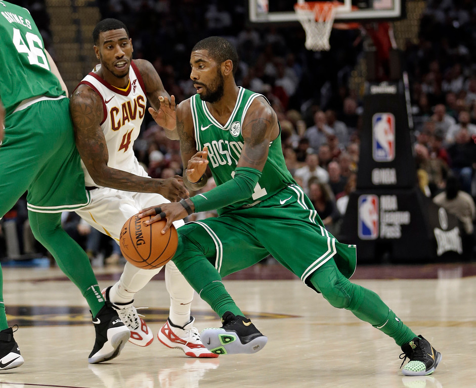 . Boston Celtics\' Kyrie Irving, right, drives past Cleveland Cavaliers\' Iman Shumpert in the first half of an NBA basketball game, Tuesday, Oct. 17, 2017, in Cleveland. (AP Photo/Tony Dejak)