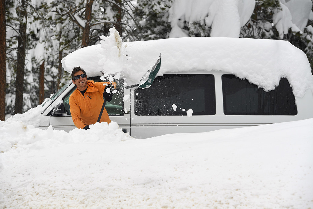 . NEDERLAND, CO - APRIL 17: Mike Pennings, uses a large shovel to clear the snow from around his van on April 17, 2016 in Nederland, Colorado. A slow moving spring storm dumped almost 3 feet of snow over a two day period in the foothills. (Photo by Helen H. Richardson/The Denver Post)