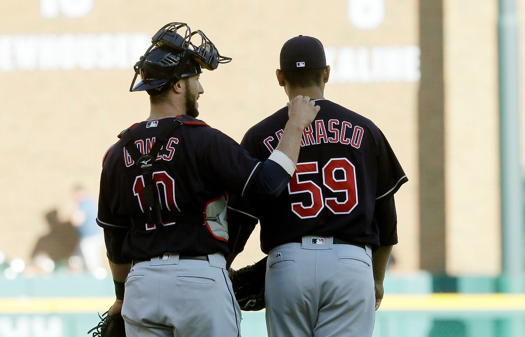 . Cleveland Indians catcher Yan Gomes (10) pats starting pitcher Carlos Carrasco on the back after Carrasco\'s four-hitter to lead the Indians to a 6-0 win over the Detroit Tigers in a baseball game, Saturday, June 25, 2016 in Detroit. (AP Photo/Carlos Osorio)