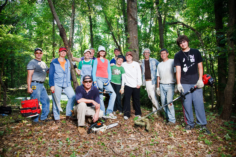 Most of the team pose by the outdooor classroom.  from left - Rich Berkowitz, Amy Creswell, Jennifer Abuaita, Cheryl Wall (back), Chad Holland (front with Chainsaw) Samantha Creswell, Scott Worley (back), Deanna Creswell, Leigh Ann Worley, Dr Glenn Baron, Peter Barbera, Andrew Barbera
