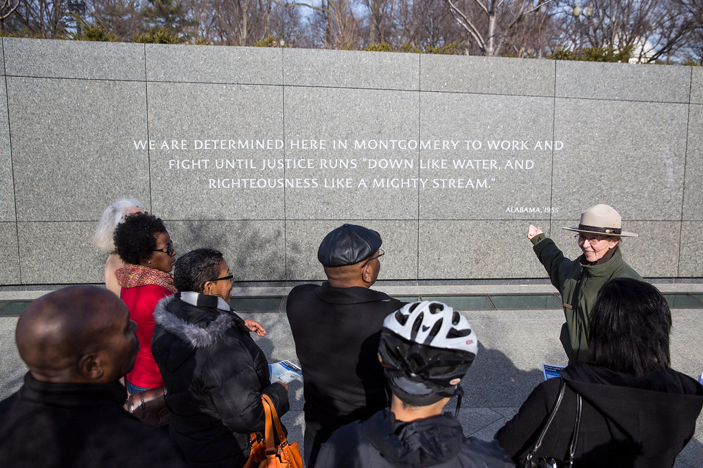 . WASHINGTON, DC - JANUARY 20:  A National Park Service Ranger gives a guided tour of the Martin Luther King, Jr. Memorial, January 20, 2014 in Washington, DC. Americans marked the birth and legacy of civil rights leader Martin Luther King, Jr. (Photo by Drew Angerer/Getty Images)
