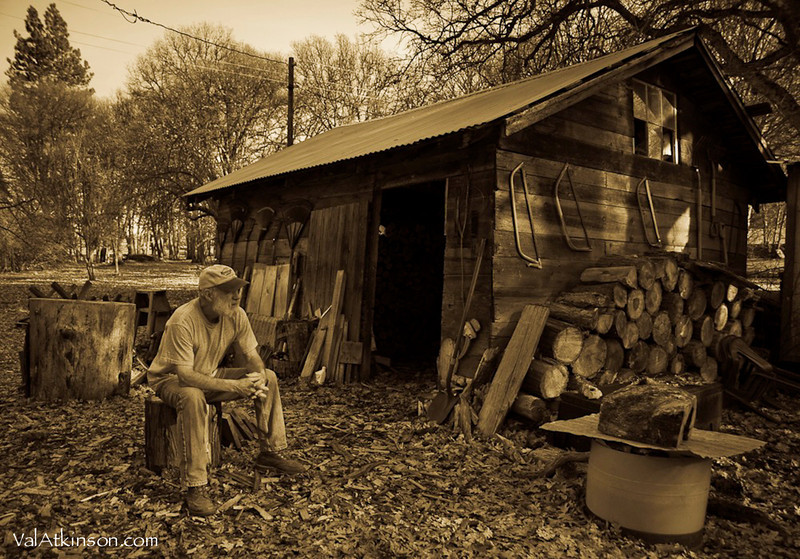 Randy Howsman outside his wood shed