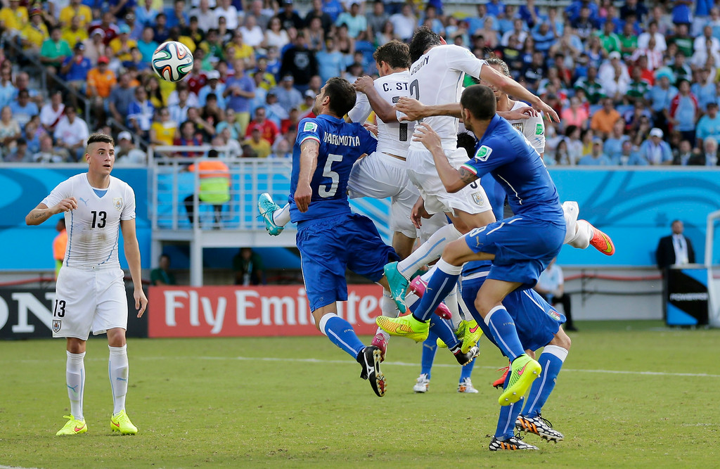 . Uruguay\'s Diego Godin, second right, heads the ball to score his side\'s first goal during the group D World Cup soccer match between Italy and Uruguay at the Arena das Dunas in Natal, Brazil, Tuesday, June 24, 2014. (AP Photo/Petr David Josek)