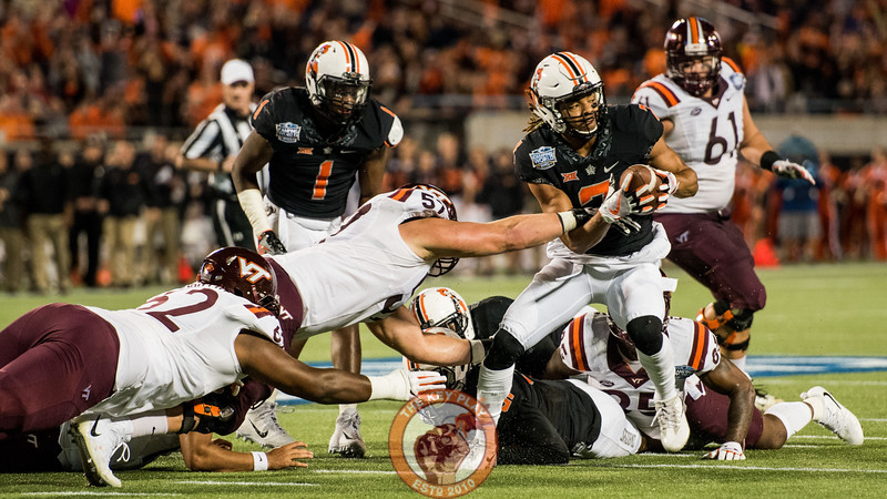 Ramon Richards (7) picks up a Virginia Tech fumble near the goal line in the Camping World Bowl between Virginia Tech and Oklahoma State in Orlando, Fl., Thursday, Dec. 28, 2017. (Special by Cory Hancock)