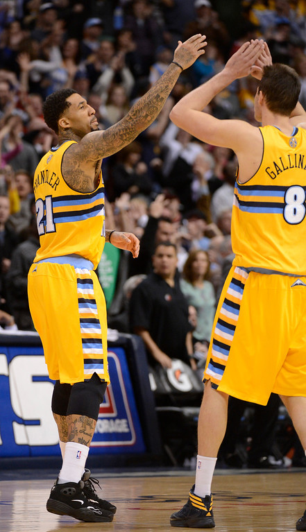 . Denver Nuggets shooting guard Wilson Chandler (21) gives a high five to Denver Nuggets small forward Danilo Gallinari (8) after hitting the game winner in overtime to defeat the Portland Trail Blazers 115-111 Tuesday, January 15, 2013 at Pepsi Center. John Leyba, The Denver Post