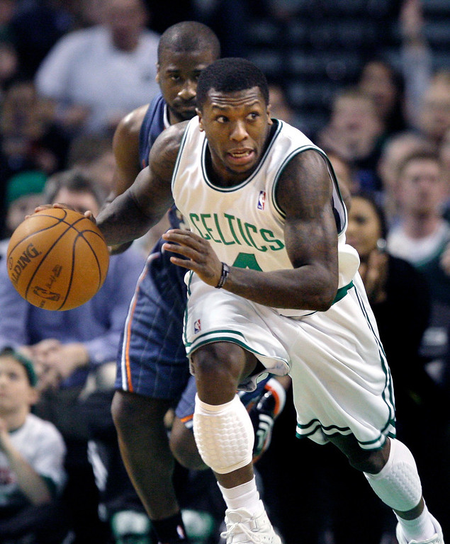 . Boston Celtics guard Nate Robinson (4) leaves Charlotte Bobcats guard Raymond Felton behind during the first half of an NBA basketball game in Boston on Wednesday, March 3, 2010. The Celtics won 104-80. (AP Photo/Elise Amendola)