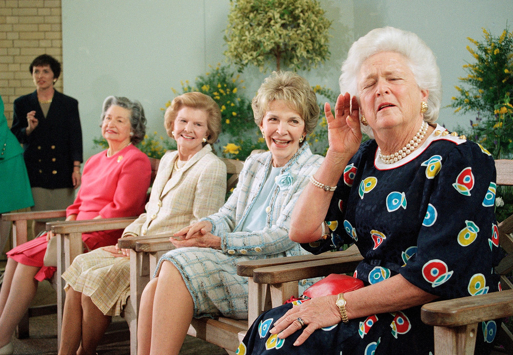 """. Former first lady Barbara Bush \""""Strains\"""" to hear a reporters question while posing with other former first ladies, on Wednesday, May 11, 1994 at the U.S. Botanic Garden in Washington. Joining Mrs. Bush, from left are; Lady Bird Johnson, Betty Ford and Nancy Reagan. The women are in Washington to attend National Garden Gala-A Tribute to America\'s First Ladies. Mrs. Bush\'s response was to a question on a former White House usher who was fired recently by current first lady Hillary Rodham Clinton. (AP Photo/Denis Paquin)"""