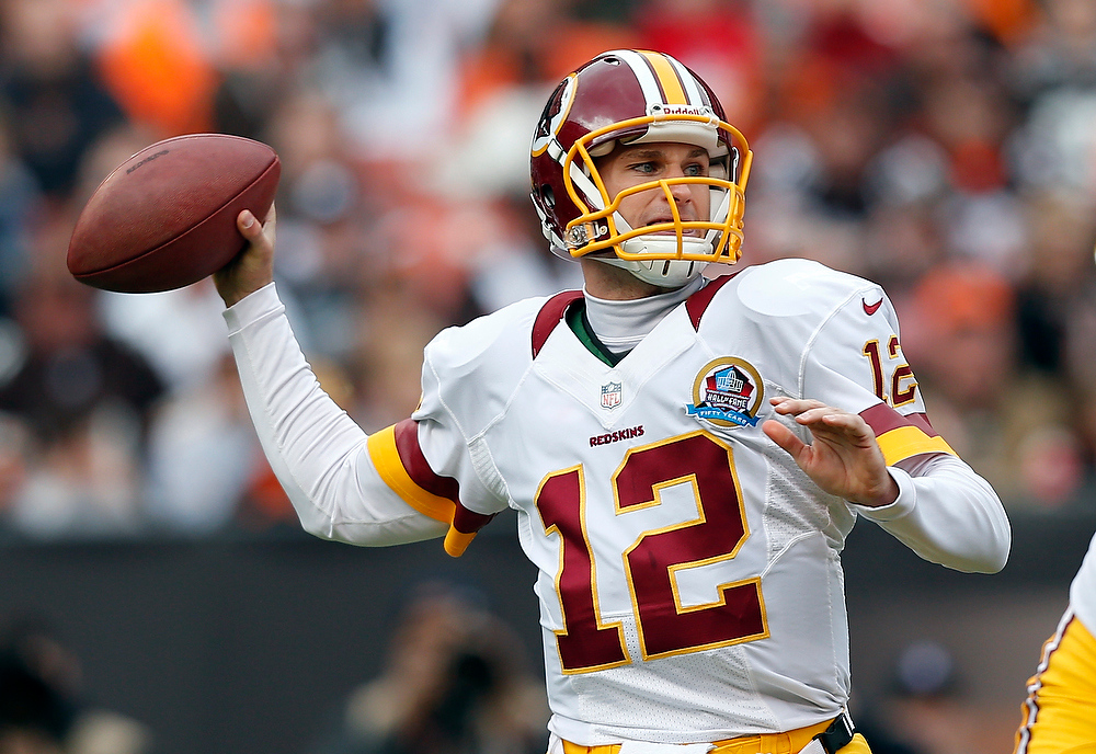 . Washington Redskins quarterback Kirk Cousins passes against the Cleveland Browns in the first quarter of an NFL football game in Cleveland, Sunday, Dec. 16, 2012. (AP Photo/Rick Osentoski)