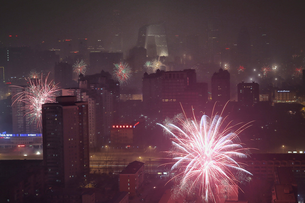 . Fireworks illuminate the skyline to celebrate Chinese Lunar New Year of Horse and cause severe air pollution on January 30, 2014 in Beijing, China.   (Photo by Feng Li/Getty Images)