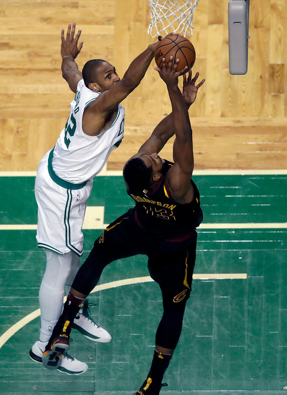 . Boston Celtics forward Al Horford, left, blocks a shot by Cleveland Cavaliers center Tristan Thompson during the first half in Game 7 of the NBA basketball Eastern Conference finals, Sunday, May 27, 2018, in Boston. (AP Photo/Charles Krupa)