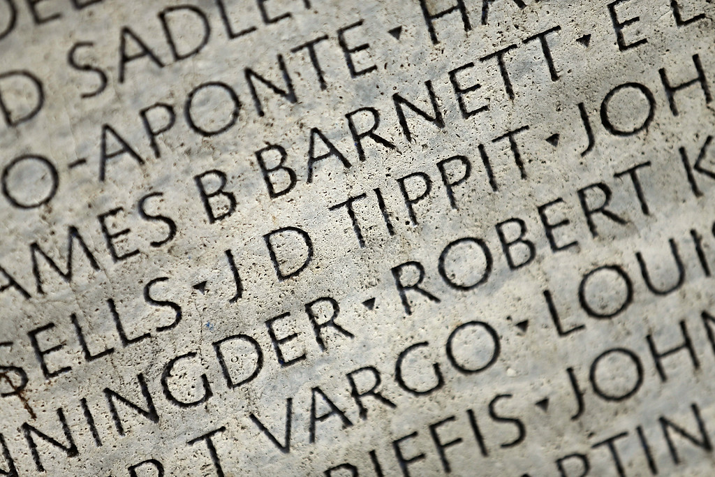 . Dallas Police Officer J.D. Tippit\'s name is shown carved into the National Law Enforcement Officers Memorial  November 22, 2013 in Washington, DC. Tippit was shot and killed by Lee Harvey Oswald when the police officer stopped to question Oswald following the assassination of U.S. President John F. Kennedy 50 years ago today.  (Photo by Win McNamee/Getty Images)