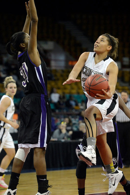 . DENVER, CO. - MARCH 9TH: Shannon Patterson, right, Pueblo South, drives to the hoop against the defense of Venessannah Itugbu, Mesa Ridge High School,  in the second half of the 4A �Great Eight� game at the Denver Coliseum, Saturday morning, March 9th, 2013. Pueblo South won 54-33 to advance to the Final Four at the CU Events Center, March 14th, 2013. (Photo By Andy Cross The Denver Post)