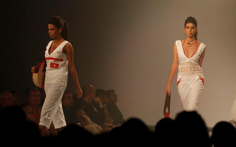 . In this Wednesday, April 3, 2013 photo, Sri Lankan models present creations by Kasuni Ratnasekera during the Colombo Fashion Week in Colombo, Sri Lanka. (AP Photo/Eranga Jayawardena)