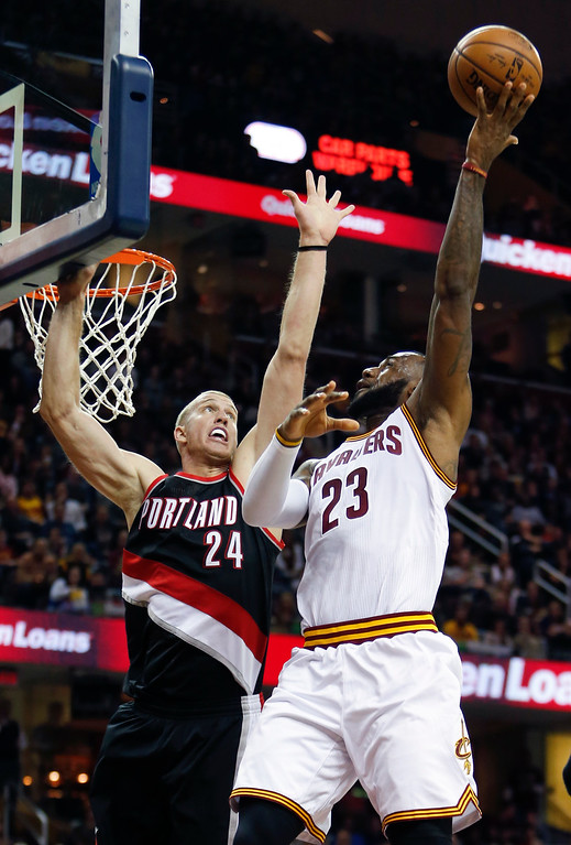 . Cleveland Cavaliers\' LeBron James (23) shoots over Portland Trail Blazers\' Mason Plumlee (24) during the first half of an NBA basketball game Wednesday, Nov. 23, 2016, in Cleveland. (AP Photo/Ron Schwane)