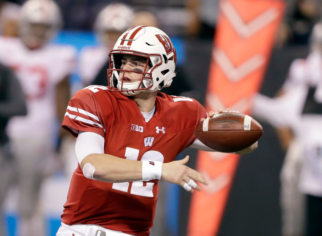 . Wisconsin quarterback Alex Hornibrook throws during the first half the Big Ten championship NCAA college football game against Ohio State, Saturday, Dec. 2, 2017, in Indianapolis. (AP Photo/Darron Cummings)