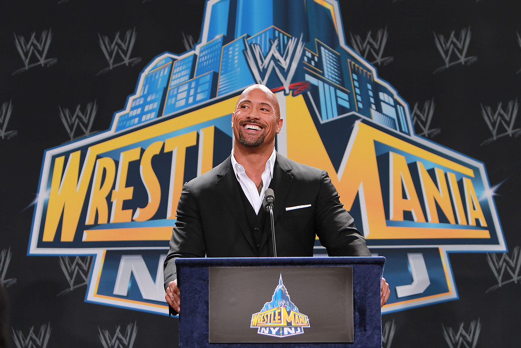 """. World Wrestling Entertainment personality Dwayne \""""The Rock\"""" Johnson speaks at a news conference in East Rutherford, N.J., Thursday, Feb. 16, 2012, to announce that MetLife Stadium will host WrestleMania XXIX on April 7, 2013. (AP Photo/StarPix, Dave Allocca)"""