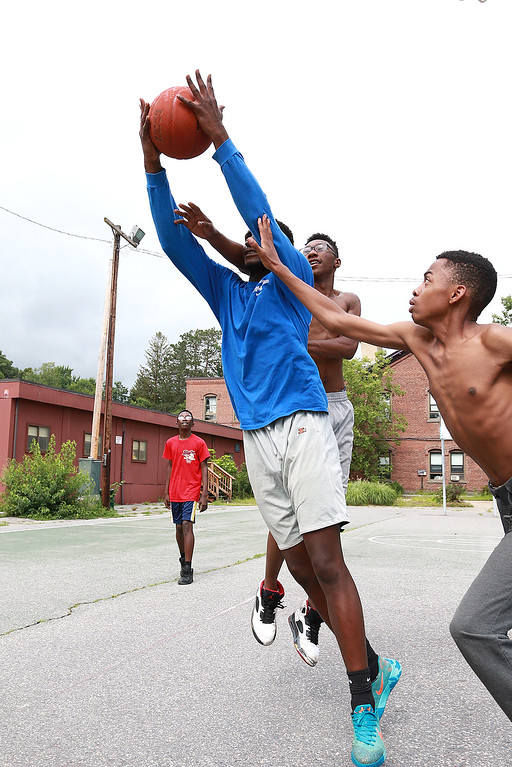 . Tuesday in Leominster started out a little cold and rainy but by around 3:30 it was just right to play a little basketball at Bennett Park on South Cotton Street with friends. Joshua Sinous, 18, goes by Kevin Paul, 18 with glasses and Rasheed Mauricette, 14, to get a rebound as they had fun playing around on the court. SENTINEL & ENTERPRISE/JOHN LOVE