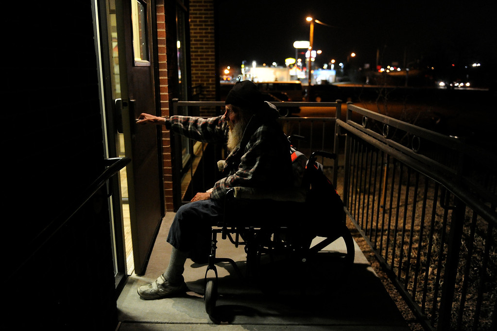 . WESTMINSTER, CO - JANUARY 22: Moon, no last name, wheels himself back inside after smoking a cigarette before lights out at Applewood Community Church in Golden, Colorado on January 22, 2014. The Jefferson County Action Center began partnering with churches last year to offer emergency shelter for the homeless on severe weather nights. (Photo by Seth McConnell/The Denver Post)