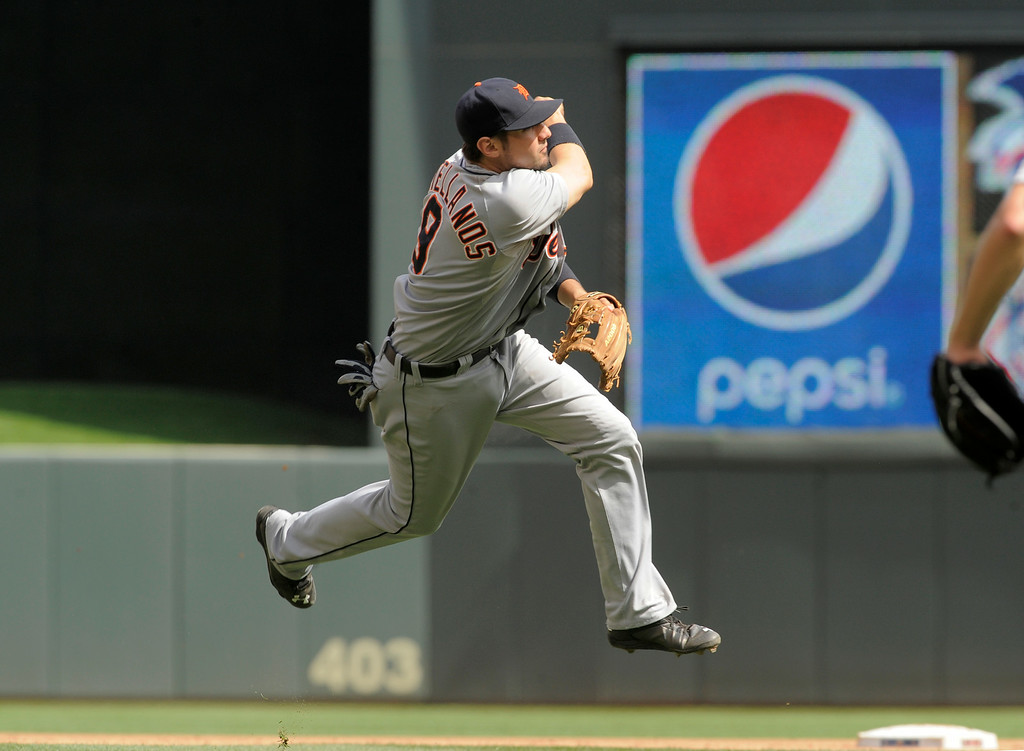 . Detroit Tigers� Nick Castellanos throws out a Minnesota Twins\' hitter during a baseball game in Minneapolis, Sunday, Aug. 24, 2014. (AP Photo/Tom Olmscheid)