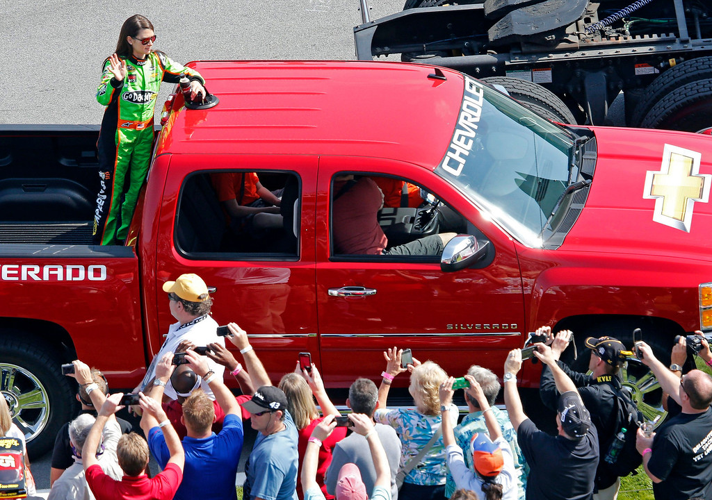 . Danica Patrick waves as she is driven on the track after driver introductions before climbing into her number 10 Chevrolet to start the first NASCAR Sprint Cup Series Budweiser Duel at the Daytona International Speedway in Daytona Beach, Florida February 21, 2013. The two Duel races determine starting positions for the field for the Daytona 500 NASCAR Sprint Cup race, scheduled for February 24.          REUTERS/Pierre Ducharme