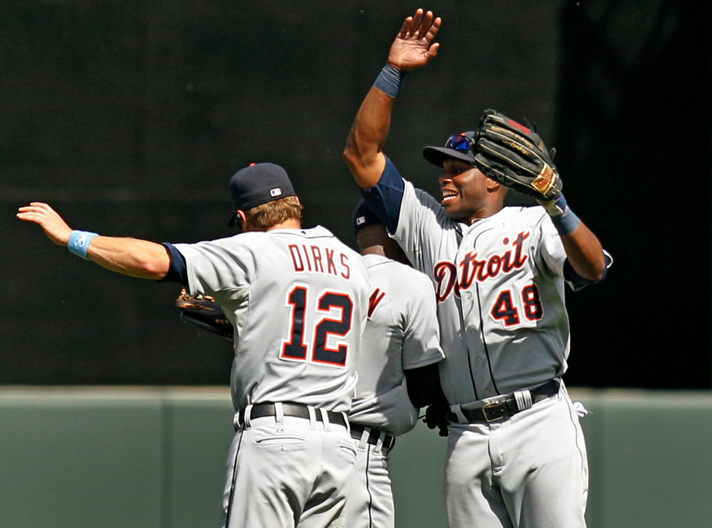. Tigers right fielder Torii Hunter, right, celebrates with left fielder Andy Dirks and center fielder Austin Jackson after Detroit\'s 5-2 win over the Twins. (AP Photo/Genevieve Ross)