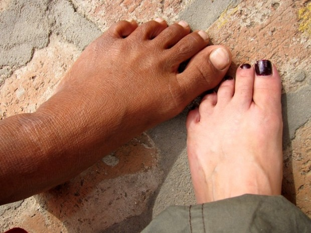 Comparing feet with a nun in Burma (Myanmar)