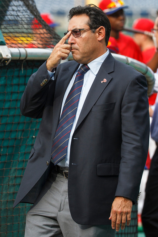 . Philadelphia Phillies\' Ruben Amaro Jr. looks on while the team warms before a baseball game against the Los Angeles Dodgers, Friday, Aug. 16, 2013, in Philadelphia. (AP Photos/Christopher Szagola)