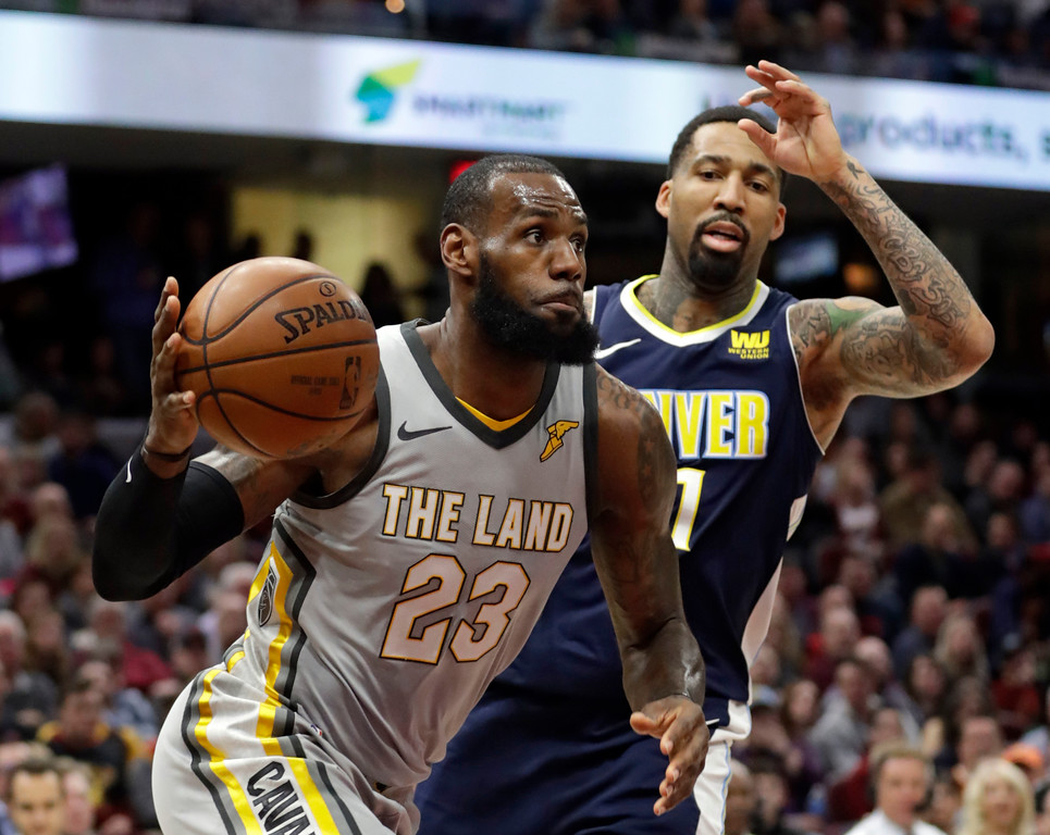 . Cleveland Cavaliers\' LeBron James (23) drives past Denver Nuggets\' Wilson Chandler (21) in the first half of an NBA basketball game, Saturday, March 3, 2018, in Cleveland. (AP Photo/Tony Dejak)