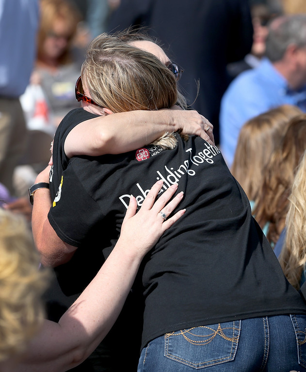 . People hug during the remembrance ceremony for the victims of last year\'s tornado on May 20, 2014 in Moore, Oklahoma.  On May 20, 2013 a two-mile wide EF5 tornado touched down in the town killing 24 people and leaving behind extensive damage to homes and businesses.  (Photo by Joe Raedle/Getty Images)