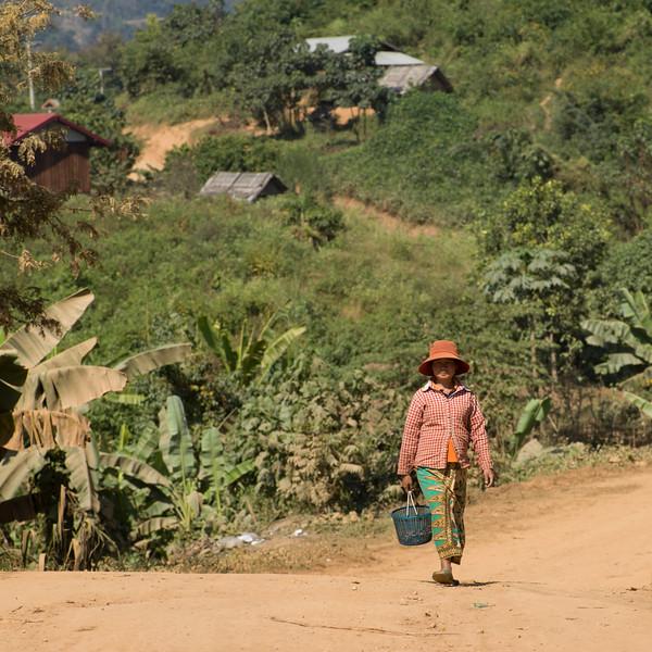 Woman carrying basket, Ban Houy Phalam, Laos