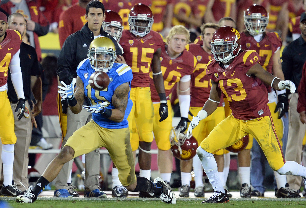. UCLA�s Devin Lucien #15 makes a catch in front of the USC bench during their game at the Los Angeles Memorial Coliseum Saturday, November 30, 2013.  UCLA beat USC 35-14. (Photo by Hans Gutknecht/Los Angeles Daily News)