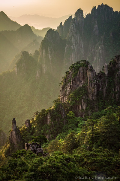 Amazing light and atmosphere. Sunrise at Huangshan (Yellow Mountain), China.