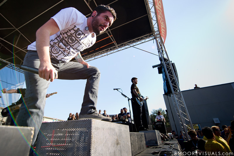 """Jeremy McKinnon and Neil Westfall of A Day To Remember perform in support of """"What Separates Me from You"""" on December 5, 2010 during 97X Next Big Thing at 1-800-ASK-GARY Amphitheatre in Tampa, Florida"""