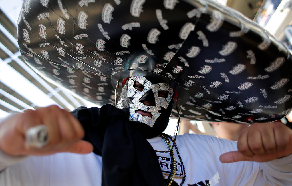. San Antonio Spurs fan Arturo Alderete cheers outside the AT&T Center before Game 2 of a Western Conference finals NBA basketball playoff series between San Antonio and the Oklahoma City Thunder, Wednesday, May 21, 2014, in San Antonio. (AP Photo/Eric Gay)