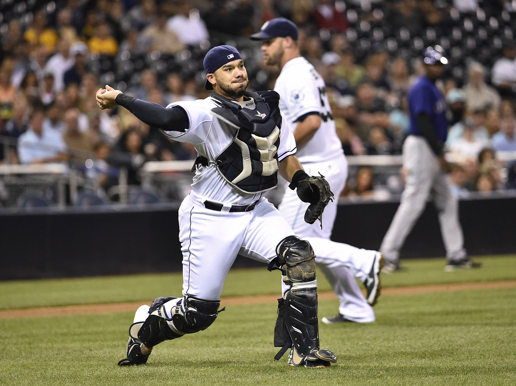 . SAN DIEGO, CA - SEPTEMBER 22:  Rene Rivera #44 of the San Diego Padres throws out Tyler Matzek of the Colorado Rockies on a bunt during the fifth inning of a baseball game at Petco Park September, 22, 2014 in San Diego, California.  (Photo by Denis Poroy/Getty Images)