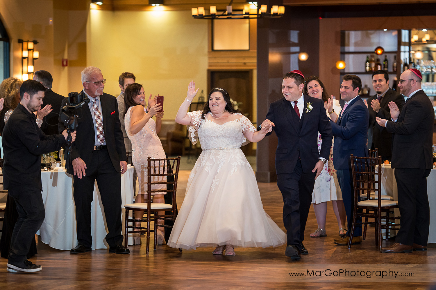 bride and groom grand entrance to wedding reception at Livermore Garre Vineyard and Winery