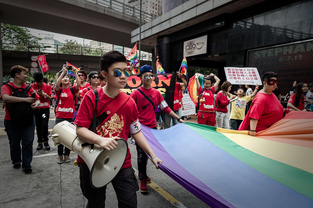 . Participants hold a flag during the gay pride parade in Hong Kong on November 9, 2013. Despite its reputation as an international financial hub, critics say Hong Kong remains a conservative city when it comes to gay rights, lacking protection for the sexual minority group despite having decriminalised homosexuality in 1991. PHILIPPE LOPEZ/AFP/Getty Images